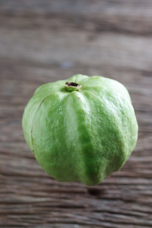 by cu: Guava isolated on wood background,Kim cu Stock Photo