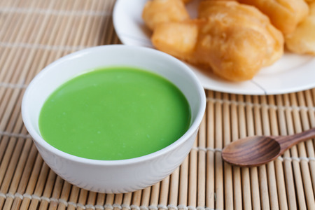 Pandan coconut custard dip and chinese bread stick or chinese donut.