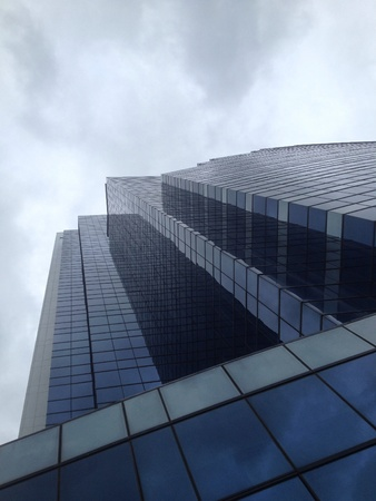 glass building: Glass building under cloudy sky