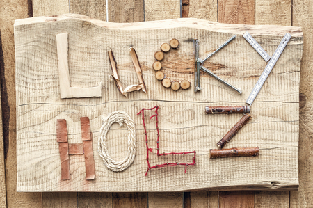 holz: The inscription of the building materials at hand lucky Holz from the German lucky tree Stock Photo