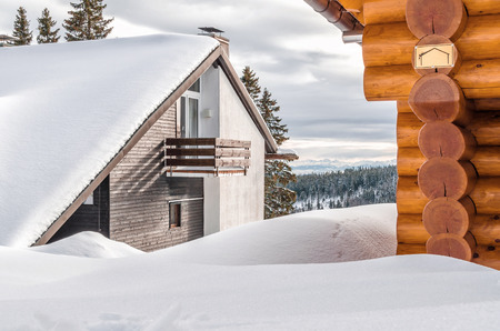 Holiday cottages in the mountains in the background alpine landscape and forests Stock Photo