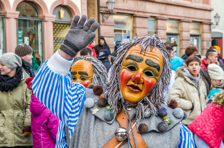 Germany, Lahr - JANUARY 17: Participants in costumes perform a street procession Carneval Fasnacht January 17, 2016 in the city of Lahr, Germany. Traditionally, the festive and cultural carnival procession through the streets of cities and towns in German