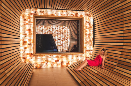 The girl visits the saline room for inhalation of the lungs and respiratory tract. Room from the Himalayan salt and dosing salt from the dead sea Stock Photo