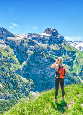 Traveler screams against the backdrop of the mountain peaks, the Engelberg resort, Switzerland