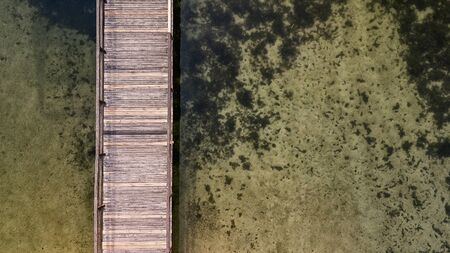 Wooden pier photo with drone. Pier, top view