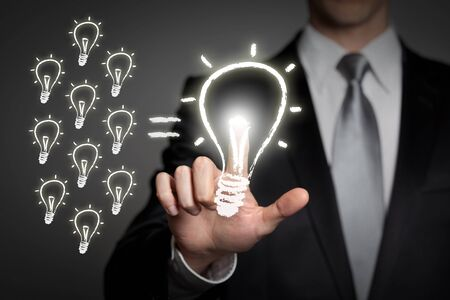internet, technology, network, business concept - businessman in suit presses virtual touchscreen interface button - glowing light bulb Banque d'images