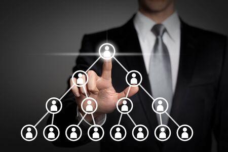 internet, technology, network, business concept - businessman in suit presses virtual touchscreen interface button - pyramid scheme