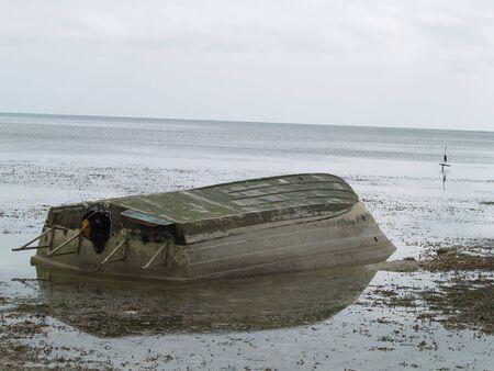 sunken boat: A sunken boat appears during low tide