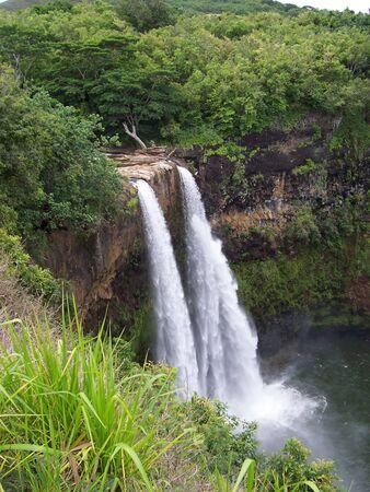 A scenic view of a Hawaiian Waterfall on Kauai photo
