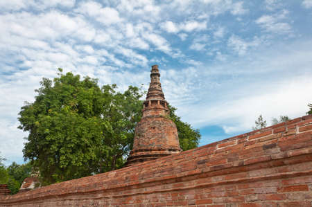 Ancient pagoda in ruined old temple at Ma Hay Yong temple in Ayutthaya, Thailand  photo