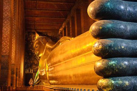 Reclining buddha statue at Wat Pho temple public place, Bangkok, Thailand photo