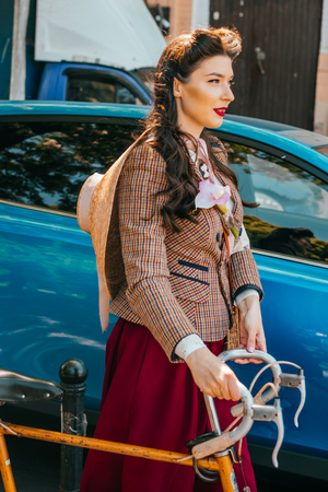 Kiev, Ukraine - May 12, 2018: Girl in tweed clothes participating in bicycle tweed run Retro cruise on May 12, 2018 in Kiev, Ukraine. Editorial