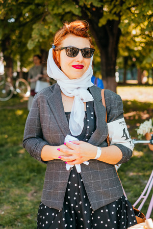 Kiev, Ukraine - May 12, 2018: Girl in vintage dress participating in bicycle tweed run Retro cruise on May 12, 2018 in Kiev, Ukraine. Editorial