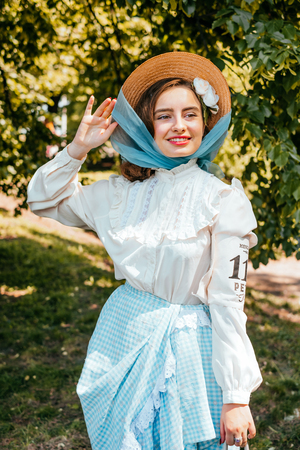 Kiev, Ukraine - May 12, 2018: Girl in straw hat, white blouse and blue color vintage skirt participating in bicycle tweed run Retro cruise on May 12, 2018 in Kiev, Ukraine.