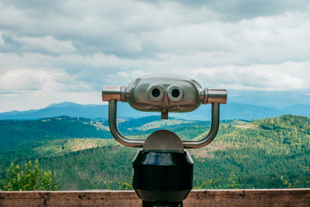 Binoculars on the viewing platform somewhere on the Carpathian mountains.