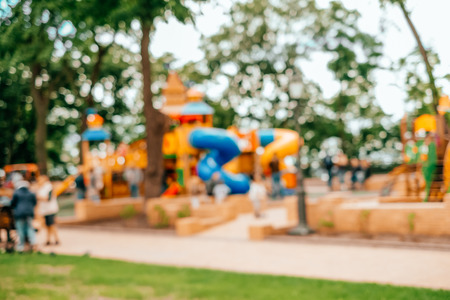 Blurred background with group of kids playing outside. 写真素材