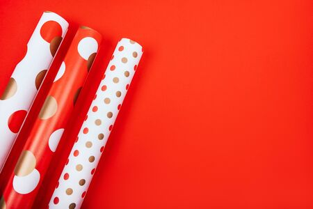 Christmas flatlay with white wrapping paper on the bright red background. Stock Photo