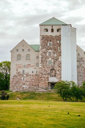 Turku, Finland - June 30, 2019: Turku Castle also known as Turun linna is one of the oldest medieval buildings in Turku.