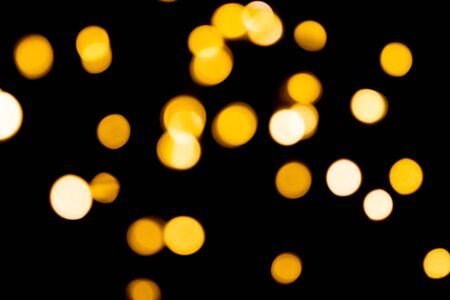 Blurred background of yellow Christmas garland lights.