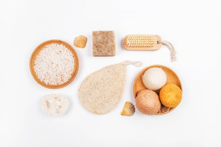 Flatlay with wooden brush, bar of soap, konjac and loofahs sponge and sea salt isolated on white background. Zero waste concept. Stock fotó