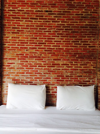 pillows: Brick wall in bedroom design