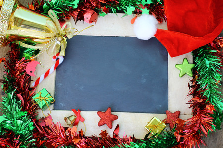 Christmas decoration and blank chalkboard Stock Photo