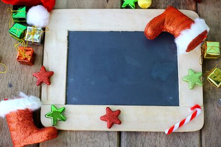 Christmas holiday background with blank chalkboard border for copy space and Christmas decorations.