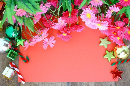 Christmas decoration, red paper and flower  on wooden Background