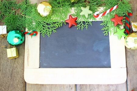 Christmas holiday decoration and chalkboard on wooden background Stock Photo