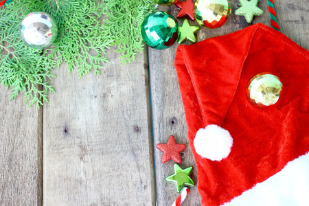 Santas hat and Christmas accessories on wooden background and copy space