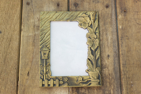 The old picture frame on wooden background
