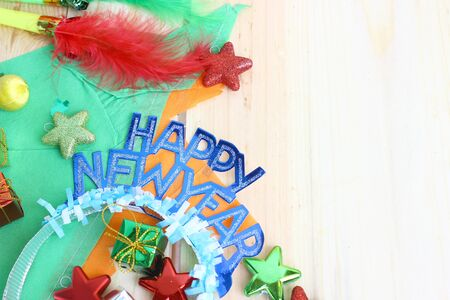 new year party  decoration on wooden background with space for text