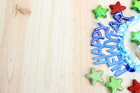 new year decoration on wooden background with space for text