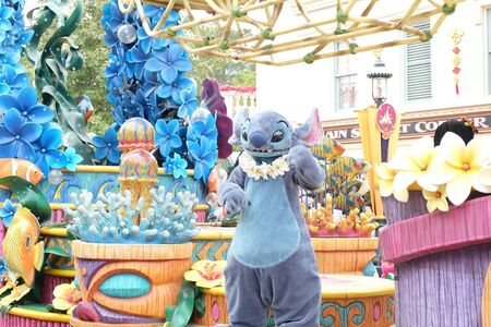 HONG KONG, CHINA - January 30,2016: Hong Kong Disneyland on January 30,2016 in Hong Kong. A parade of cartoon character Stitch. A famous cartoon of Walt Disney at Hong Kong Disneyland