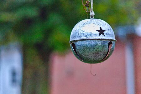 decoration bell with a star in front of a house Stock Photo