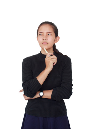 A Beautiful woman wore a black blouse with a blue skirt holding a white pen and serious thinking something. Isolated on white background 스톡 콘텐츠