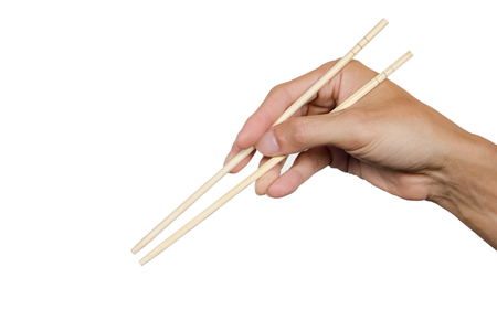 Hand holding chopsticks and ready to eat isolated on white background. Clipping path.