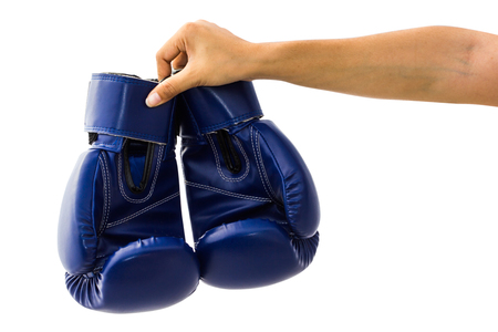 Hand holding boxing mitts isolated on white background with clipping path. Blue boxing glove usually used in training boxers and other combat. Stock Photo