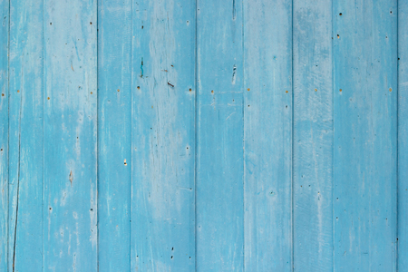 Blue wood textured wall background.