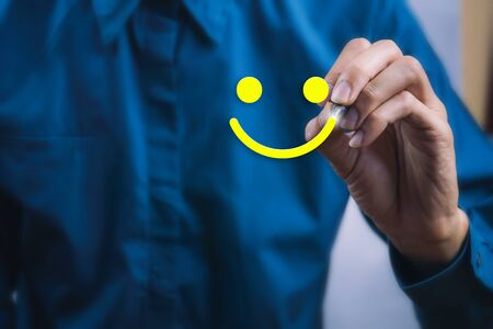 Conceptual the customer responded to the survey. The client using digital pen write happy face smile icon. Depicts that customer is very satisfied. Service experience and satisfaction concept. Stok Fotoğraf