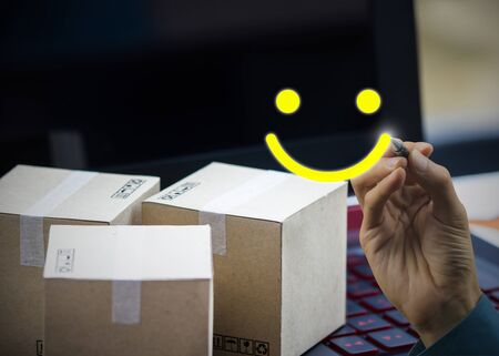 Conceptual the customer responded to the survey. The client writing a smiley face icon after shopping online. Depicts that customer is very satisfied. Service experience and satisfaction concept. Stok Fotoğraf