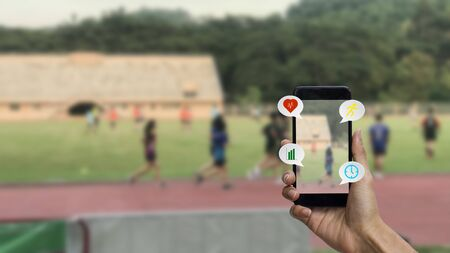 Smart health exercise checking concept. A man hand using smartphone checking heart rate, distance, calories and timing. Stok Fotoğraf