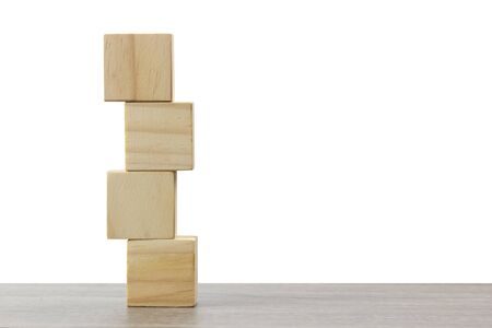 stack of wooden block on wood table against white background.