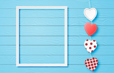 Valentines day banner with hanging cute heart shape and frame on blue background in paper cut style. Digital craft paper art concept.