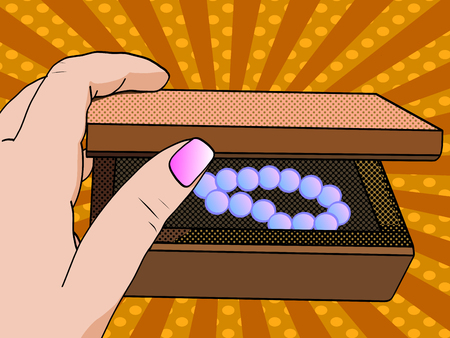 Woman hand opening jewelry box. Close-up opens the casket. Pop art