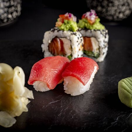 Sushi on a plate dark food photography style 版權商用圖片