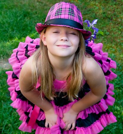 portrait of beautiful  little girl with hat in the garden photo