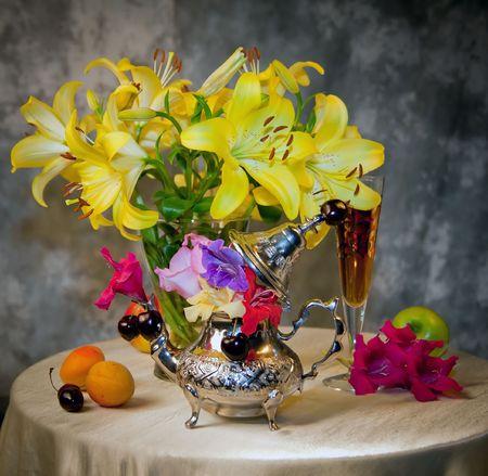 Beautiful flowers and fresh fruits  photo