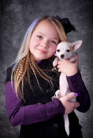 Portrait of the beautiful girl with chihuahua  photo