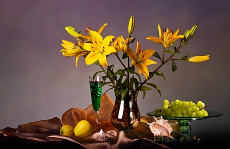 Still life with yellow lily and fresh fruits Stock Photo - 14332336